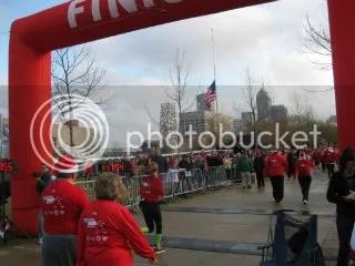 Me crossing the finish line of the Santa Hustle Half Marathon - Indianapolis, Indiana