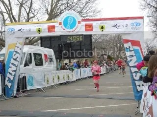 Me crossing the finish line of the Lake Minnetonka Half Marathon - Excelsior, Minnesota