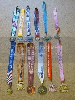 10K - Half Marathon Medals - Top Row: Chicago Half Marathon (2011), Big Hit Quarter Marathon (2011), OneAmerica 500 Festival Mini Marathon (2012), Rock 'N Sole Quarter Marathon (2012), Minneapolis Half Marathon (2012), Indianapolis Women's Half Marathon (2012); Bottom Row: Air Force Marathon 10K (2012), Big Hit Quarter Marathon (2012), Hershey Half Marathon (2012), Louisville Sports Commission Half Marathon (2012), Santa Hustle Half Marathon (2012), Disney Princess Half Marathon