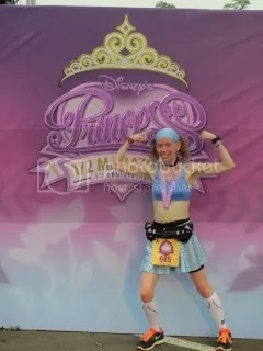 Me striking a pose for a strong finish and a new PR at the Disney Princess Half Marathon