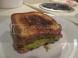 A gluten-free grilled cheese and guacamole sandwich made with Udi's Gluten-Free Millet-Chia Bread