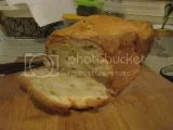 A loaf of bread made with Gluten Free You And Me Gluten Free French White Bread Mix and baked in the oven