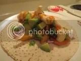 Udi's Gluten-Free Plain Tortilla topped with Sophie's Kitchen Gluten-Free Vegan Breaded Shrimp, red onion, avocado, and vegan Sriracha sour cream