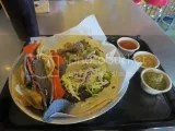 Taco Punk's Black Beans & Cheese Taco and Seasonal Veggie Mole Taco with a side of chips and three house made salsas