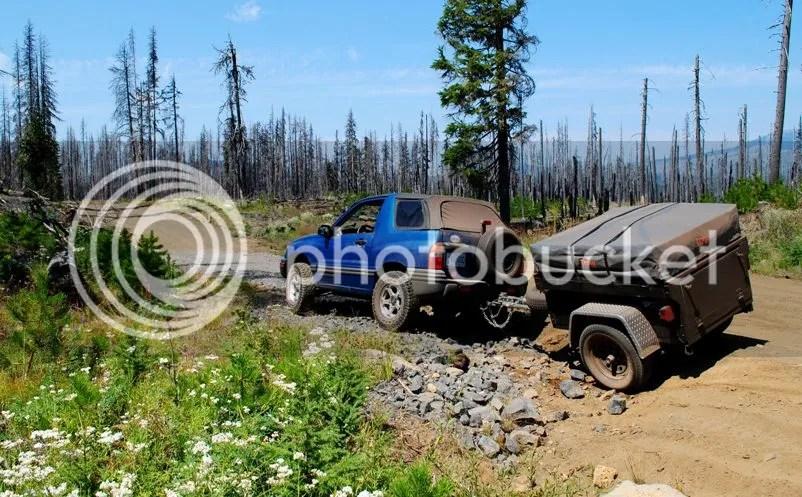 Jeep Trailer Dinoot M416 on Santiam Wagon Trail Oregon rough patch