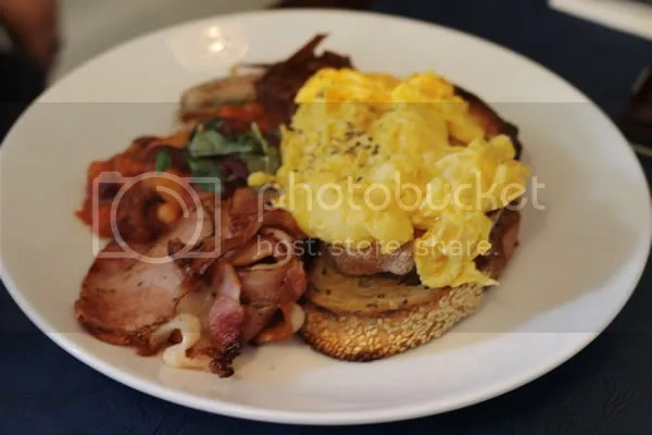 Deli Breakfast – free range eggs on toast, bacon, Italian pork sausages & baked beans