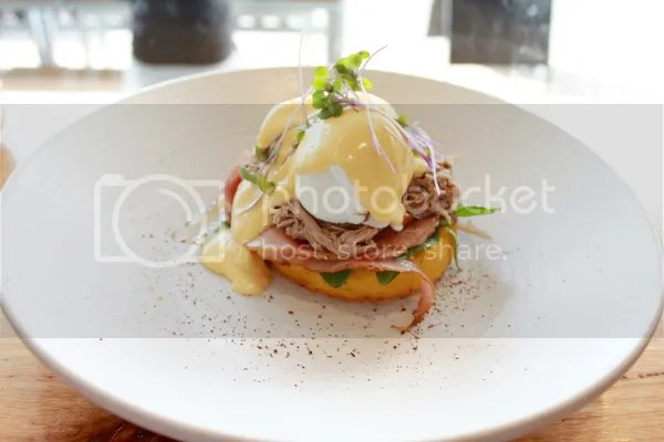 Eggs benny - with pulled pork, ham, baby spinach, apple cider Hollandaise & poached eggs on a polenta cake.