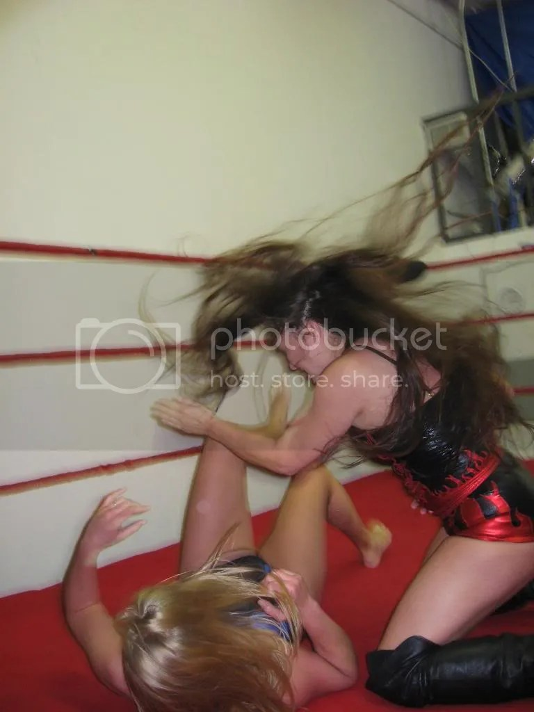 Malia Hosaka comes crashing down onto Misty James with a diving double karate chop to her mid-section photo IMG_0531.jpg