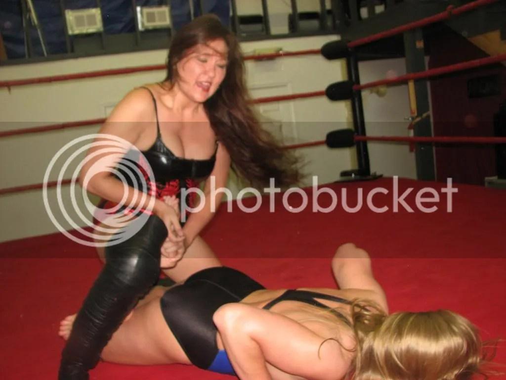 Malia Hosaka crosses the ankles of Misty James photo IMG_2134.jpg