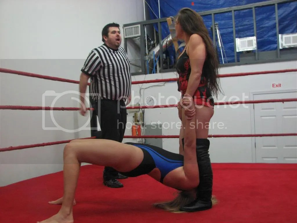 Malia Hosaka pulls up on the arms and stands on the hair of Misty James photo IMG_2143.jpg
