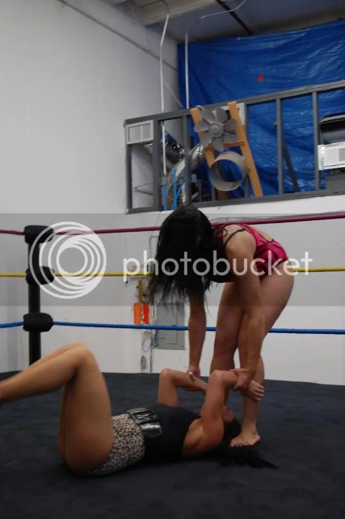 """Smokin' HOTT"" Nikki Lane stands on the hair of Santana Garrett..... photo DSC_0433.jpg"