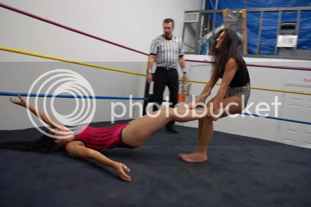 """Santana Garrett drags """"Smokin' HOTT"""" Nikki Lane across the rign by her ankles photo DSC_0477.jpg"""