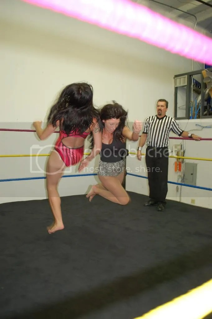 "Santana Garrett takes ""Smokin' HOTT"" Nikki Lane off of her feet from an Irish Whip with a flying clothesline photo DSC_0483.jpg"