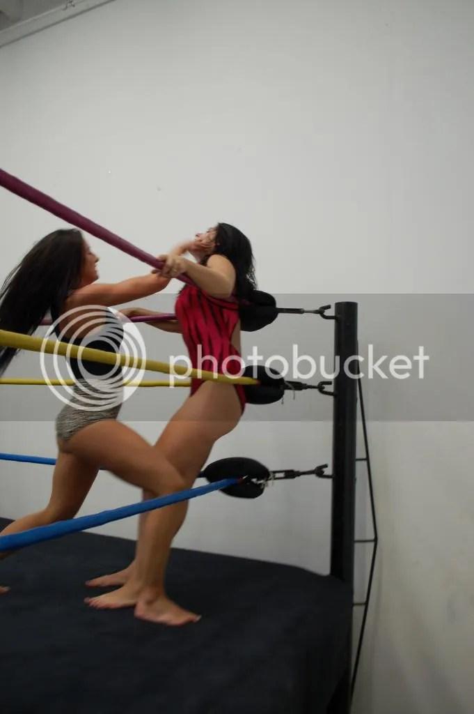 "Santana Gareet is sbout to rearrange the facial features of ""Smokin' HOTT"" Nikki Lane in the corner photo DSC_0484.jpg"