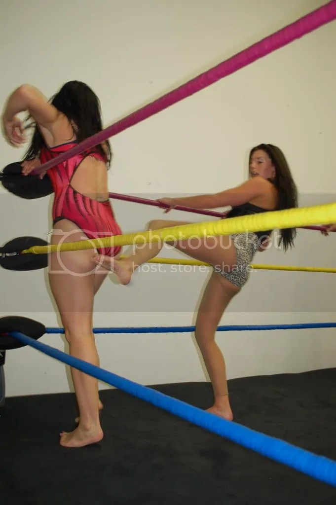"Santana Garrett delivers a hard left foot kick to the posterior of ""Smokin' HOTT"" Nikki Lane in the corner photo DSC_0488.jpg"