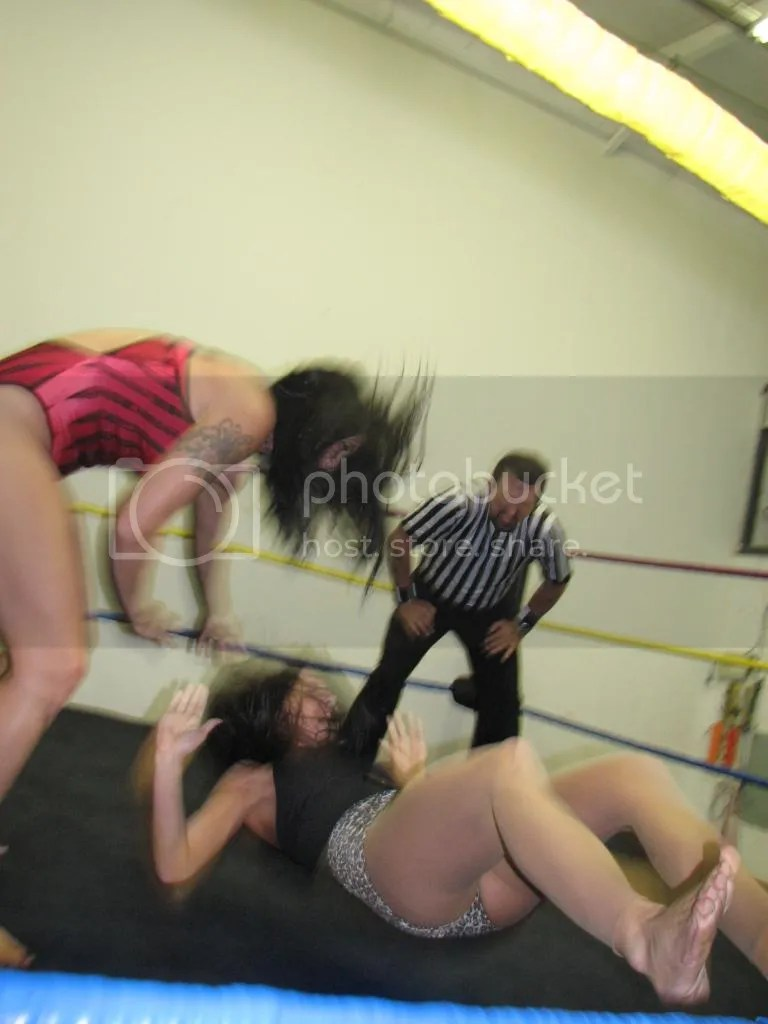 """Smokin' HOTT"" Nikki Lane grabs the back of the hair of Santana Garrett and she yanks her down hard to the canvas photo IMG_1811.jpg"