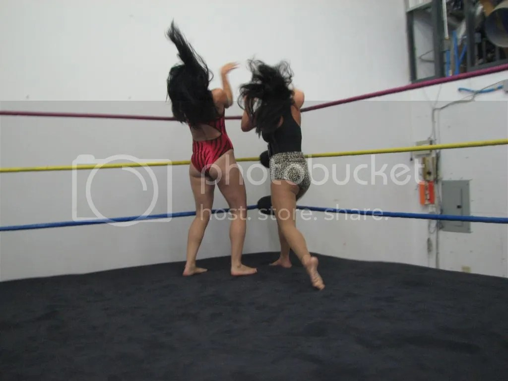 """Smokin' HOTT"" Nikki Lane rams Santana Garrett head first into the top ring turnbuckle in the opposite corner photo IMG_1826.jpg"
