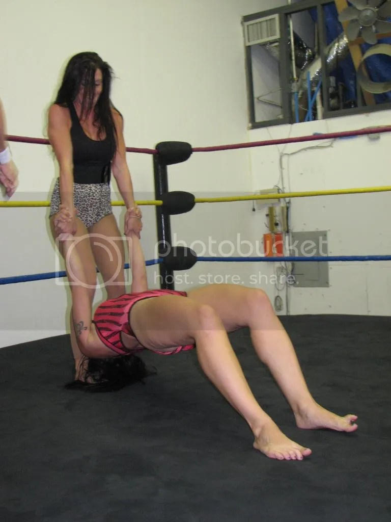 "The wrestling action reconvenes inside the ring as SAntanaGarrett stans on the hair asn she pulls up on the arms of ""Smokin' HOTT"" Nikki Lane photo IMG_1849.jpg"