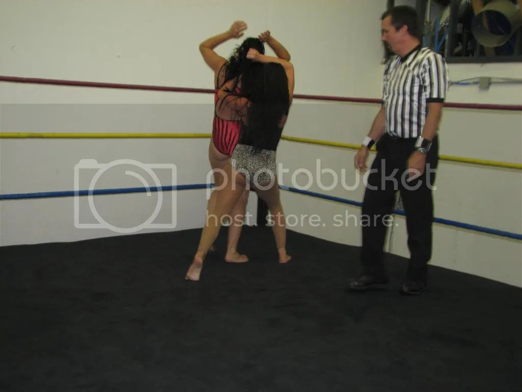"....and Santana Garrett rams ""Smokin' HOTT"" Nikki Lane head first into the top ring turnbuckle in the corner photo IMG_1856.jpg"