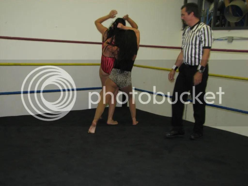 "....and Santana Garrett rams ""Smokin' HOTT"" Nikki Lane head first into the top ring turnbuckle in the corner photo IMG_1856.jpg"