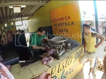 Buying meat at the local market