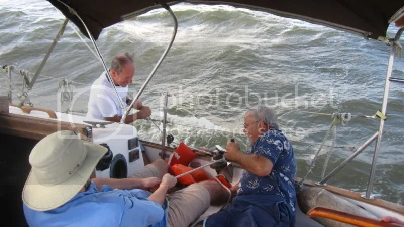 Tate, Gary and George attempting to winch Adelante's jib