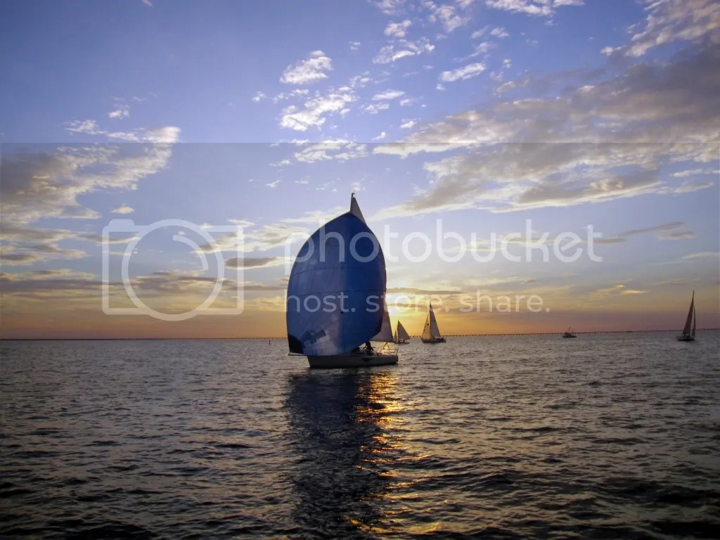 Sailing spinnaker at sunset
