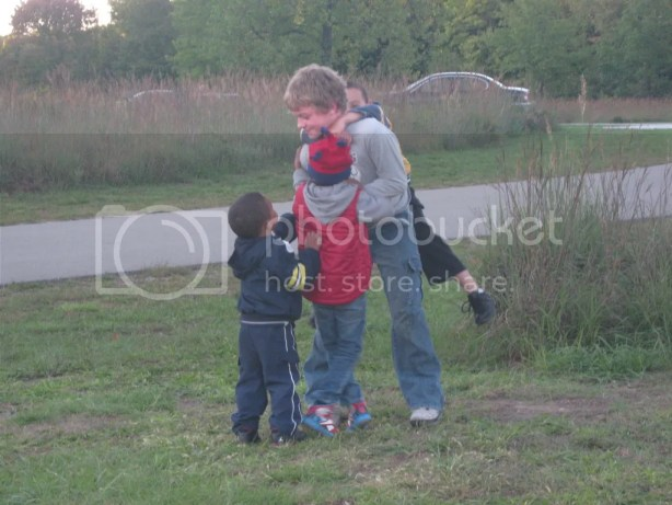 Aiden wrestling with the boys at the Camptown campout at Fort Harrison State Park in Indianapolis, Indiana