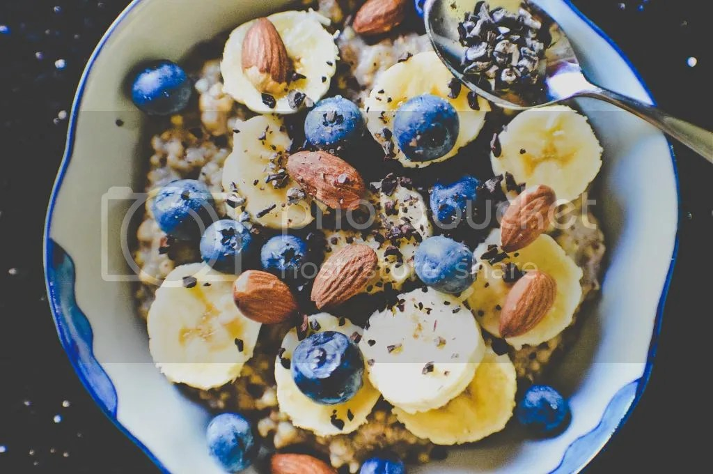 Creamy Banana Buckwheat Porridge with Blueberries, Almonds & Cacao Nibs