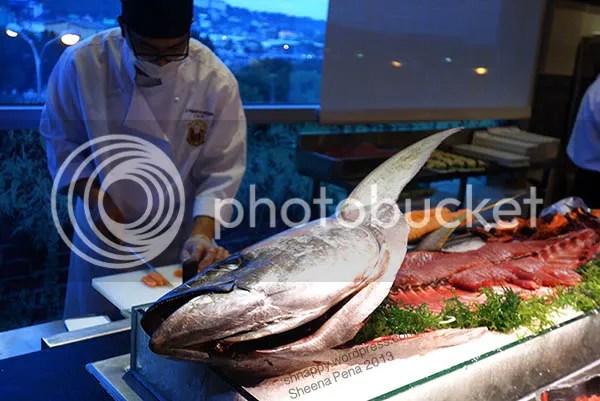 sushi chef making sashimi from a very big tuna at Vikings Marikina