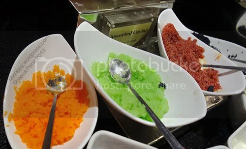 orange, green and red caviar served on bowls