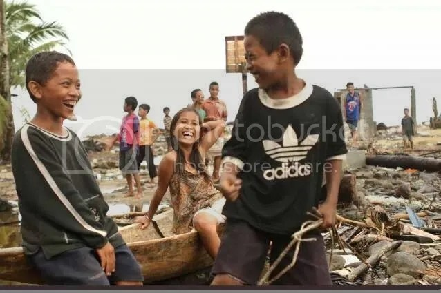 Kids smiling after Typhoon Haiyan