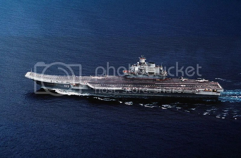 The Admiral Kuznetsov. The ski jump at the bow is clearly visible. The helicopters on the aft deck provide scale.