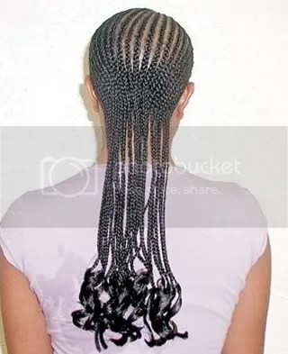 Photo of long cornrow hairstyle.