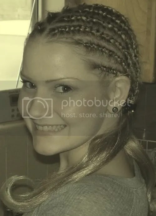 Image of a white girl with long cornrow.