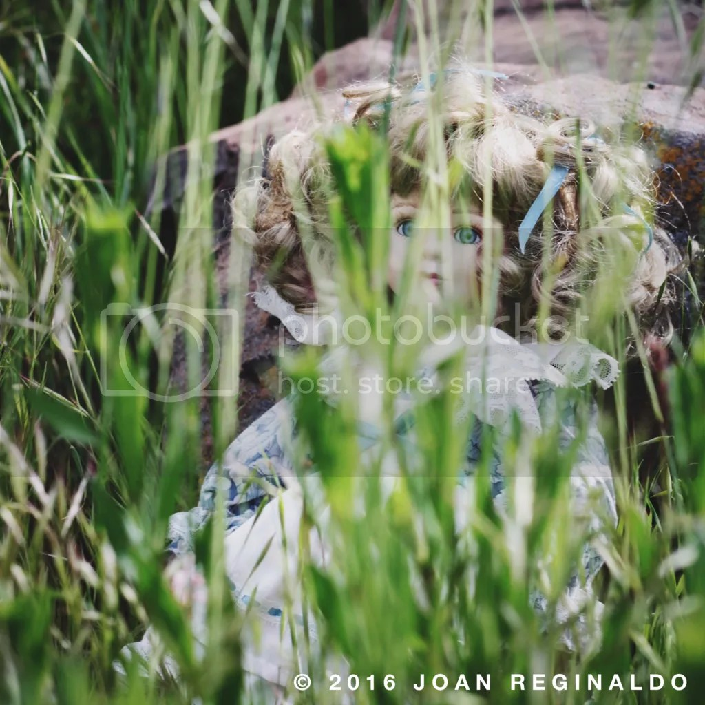 photo Creepy Blonde doll in weeds_zpsjbolcqh7.png