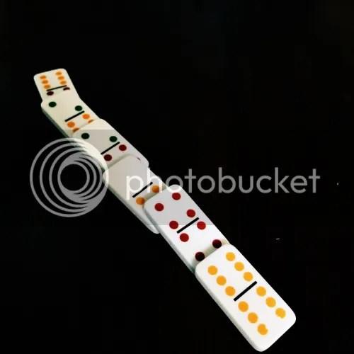 photo Fallen white Dominoes on dark background_zps3x316aeb.jpg