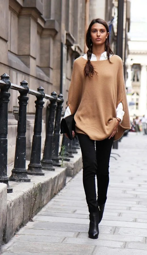 LE FASHION BLOG STREET STYLE CAMEL CAPE TAN PONCHO WHITE BUTTON UP COLLARED SHIRT SKINNY BLACK JEANS BLACK ANKLE BOOTS BOOTIES BLACK FOLDED CLUTCH MESSY SIDE BRAID HAIR VIA PAPER BLOG photo LEFASHIONBLOGSTREETSTYLECAMELCAPEVIAPAPERBLOG.jpg