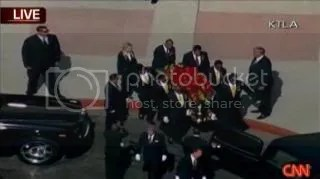 Michael Jackson's casket being carried by pallbearers