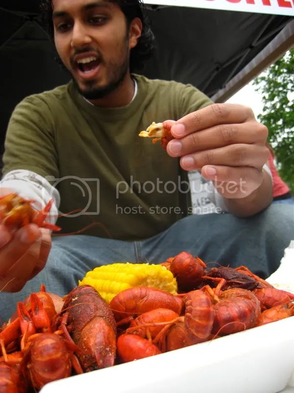 Sajan eats crawfish