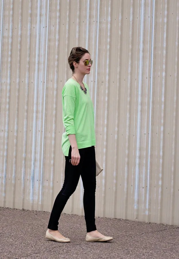 neon green sweater and black pants