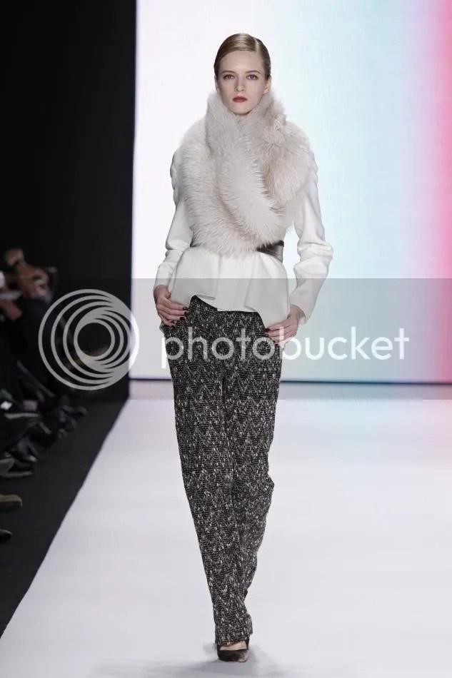 17. Daria: Bone wool tailored jacket, cocoa herringbone trouser, fox scarf, mauve velvet belt.
