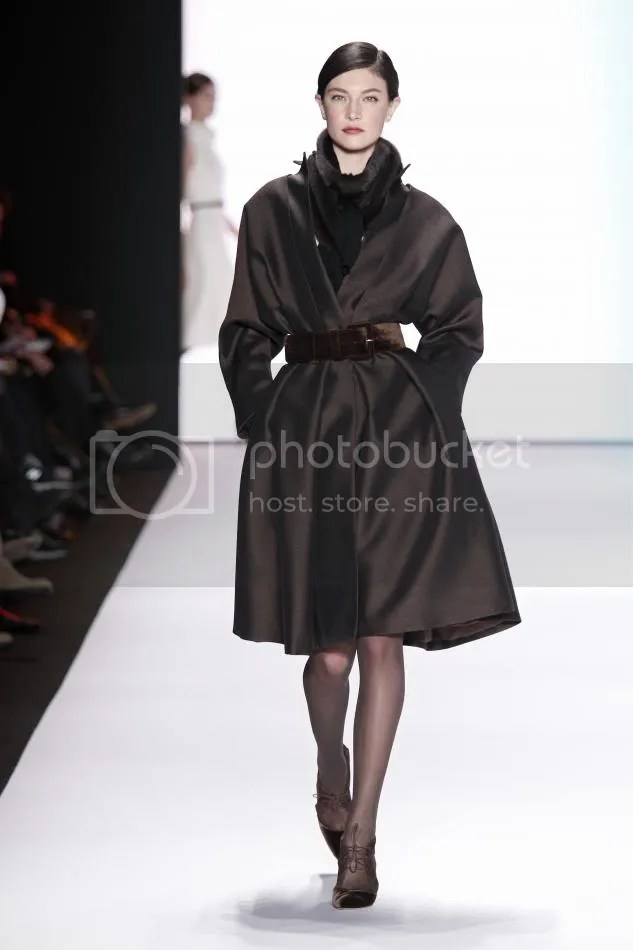 18. Jacqelin: Cocoa silk and wool organdy coat dress, ranch mink scarf, cocoa velvet belt, cocoa embroidered gloves.
