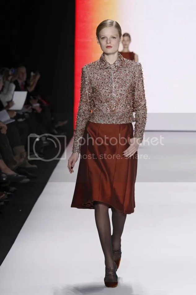 25. Hanne: Rust and primrose embroidered jacket, rust silk and wool organdy wing skirt.
