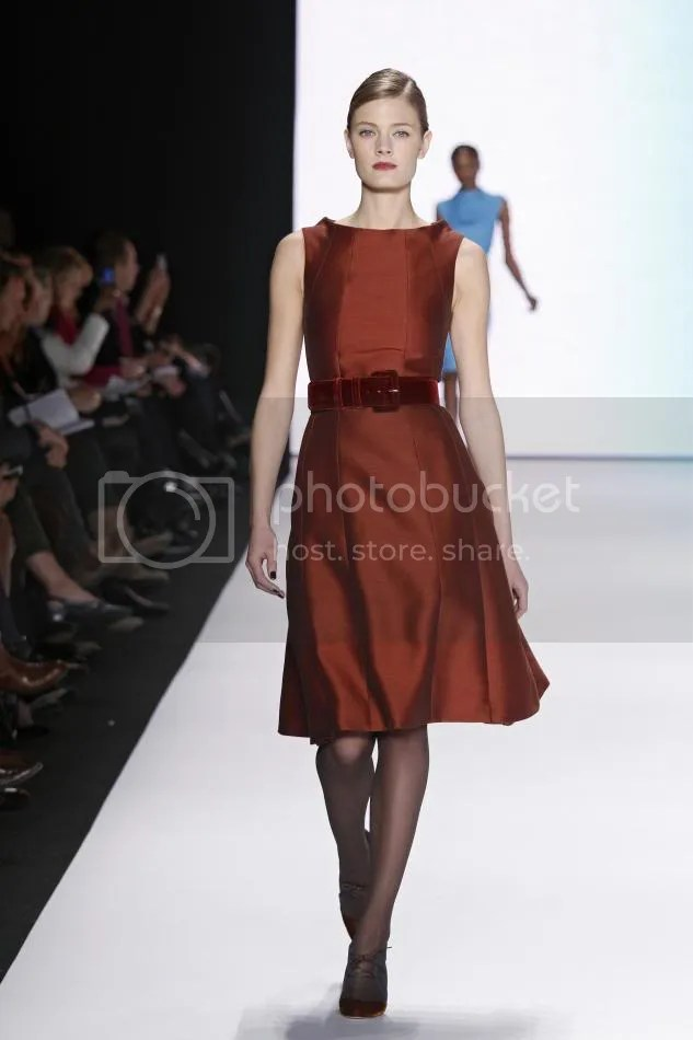 26. Rust silk and wool trapeze dress and rust velvet belt.