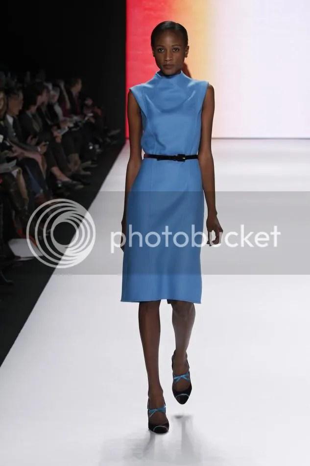 27. Aminata: Sapphire wool pencil dress and amethyst velvet belt.
