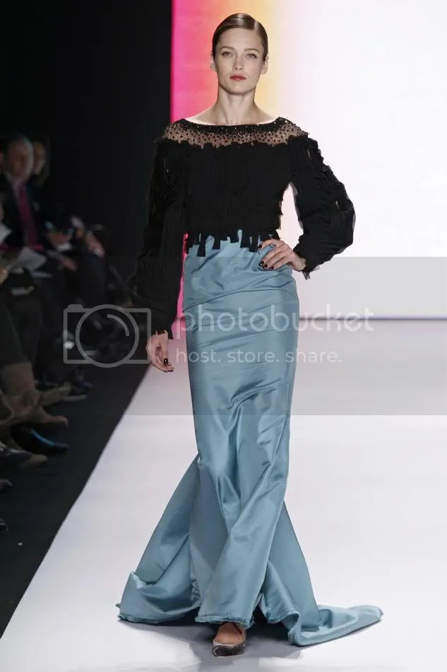33. Karmen: Black and turquoise silk chiffon and faille long sleeve embroidered gown.