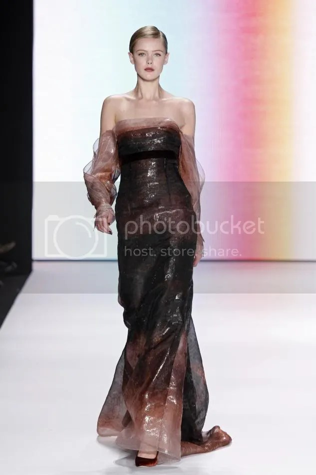 40. Frida:Rust abstract print organza gown.