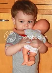 Doll hugs