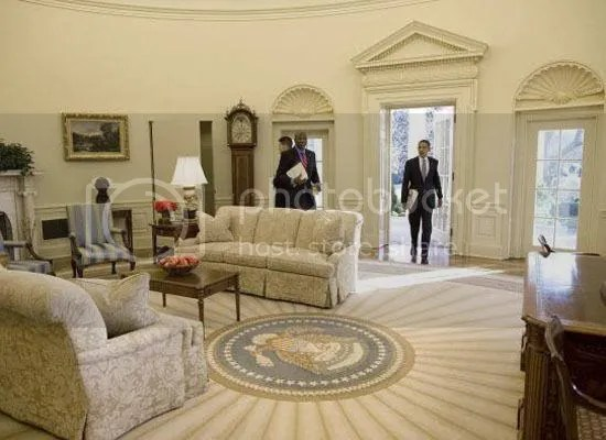 Obama enters his office for his first full day of work...